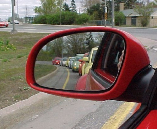 Line of New Beetles taken in side mirror